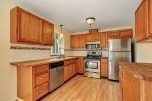 Wooden kitchen interior with custom cabinetry